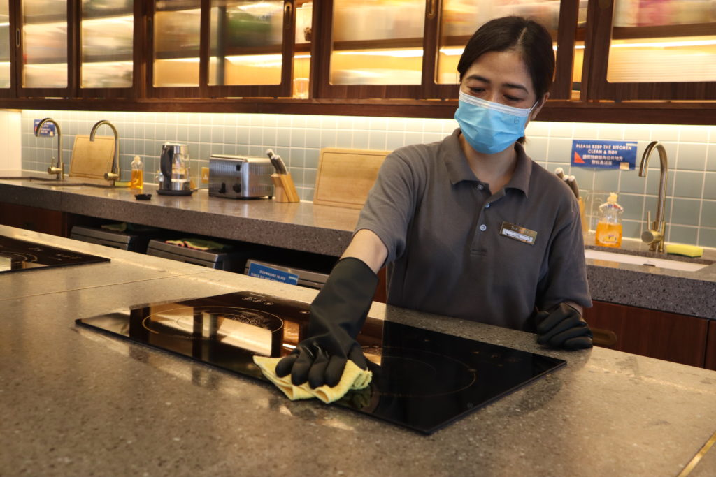 Magic Clean's staff is cleaning the kitchen at The Nate